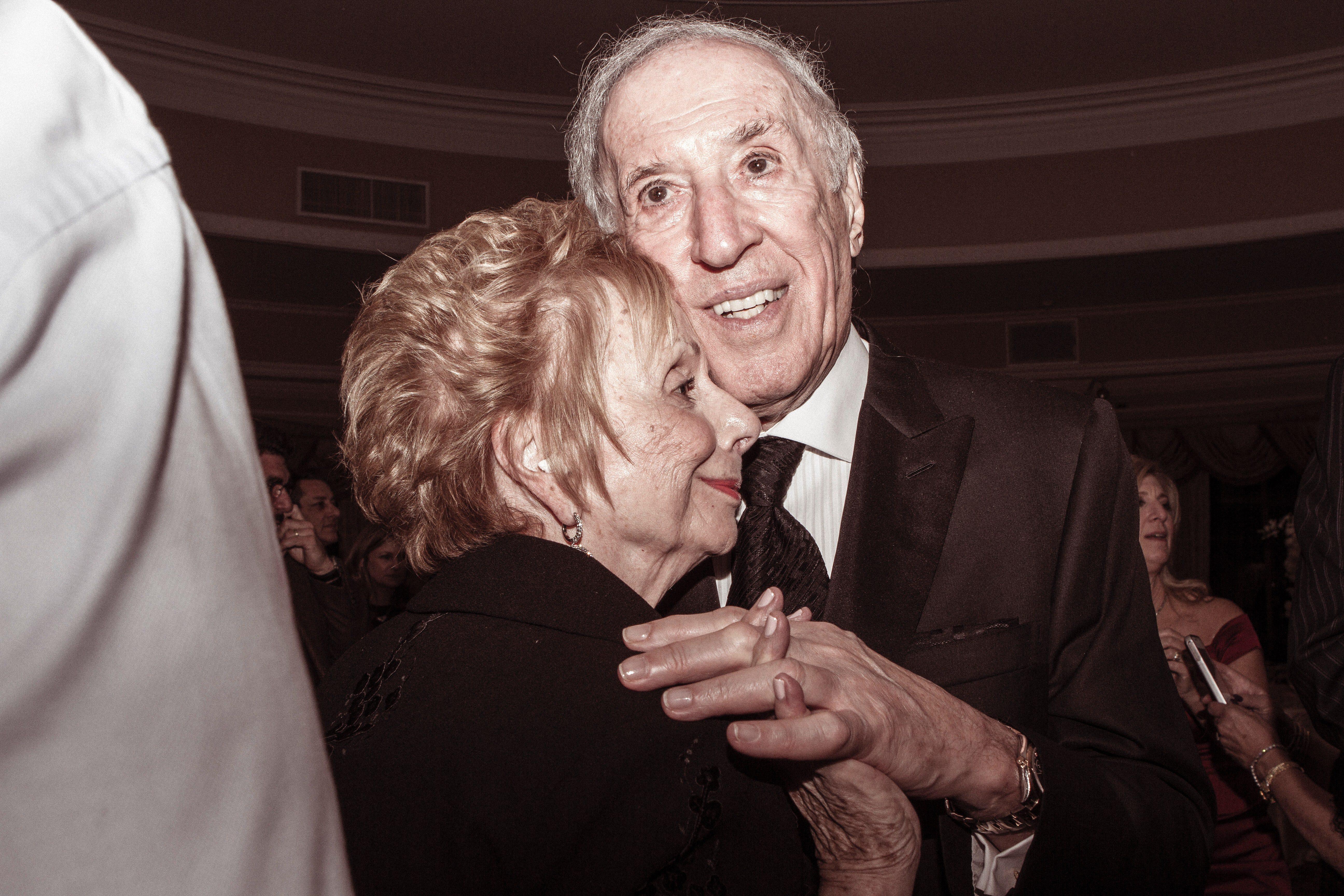 elderly man with woman